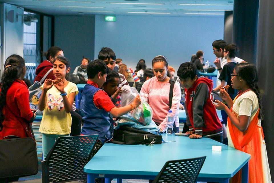 Kids enjoying the JHACK competition finale